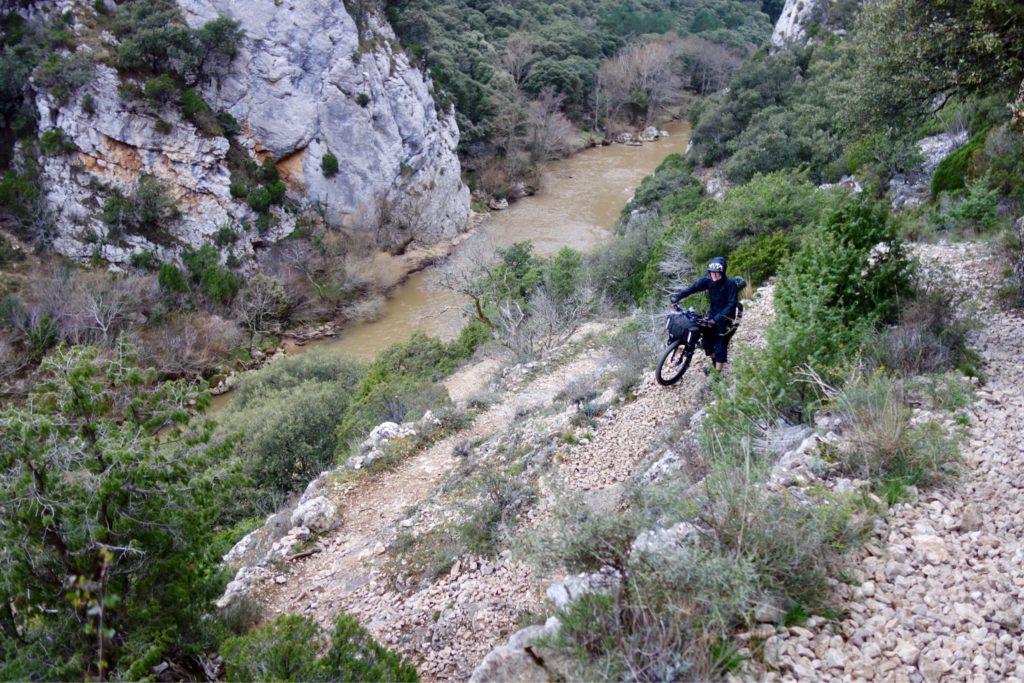 Pushing a bike down a hiking trail near the Rio Ebro